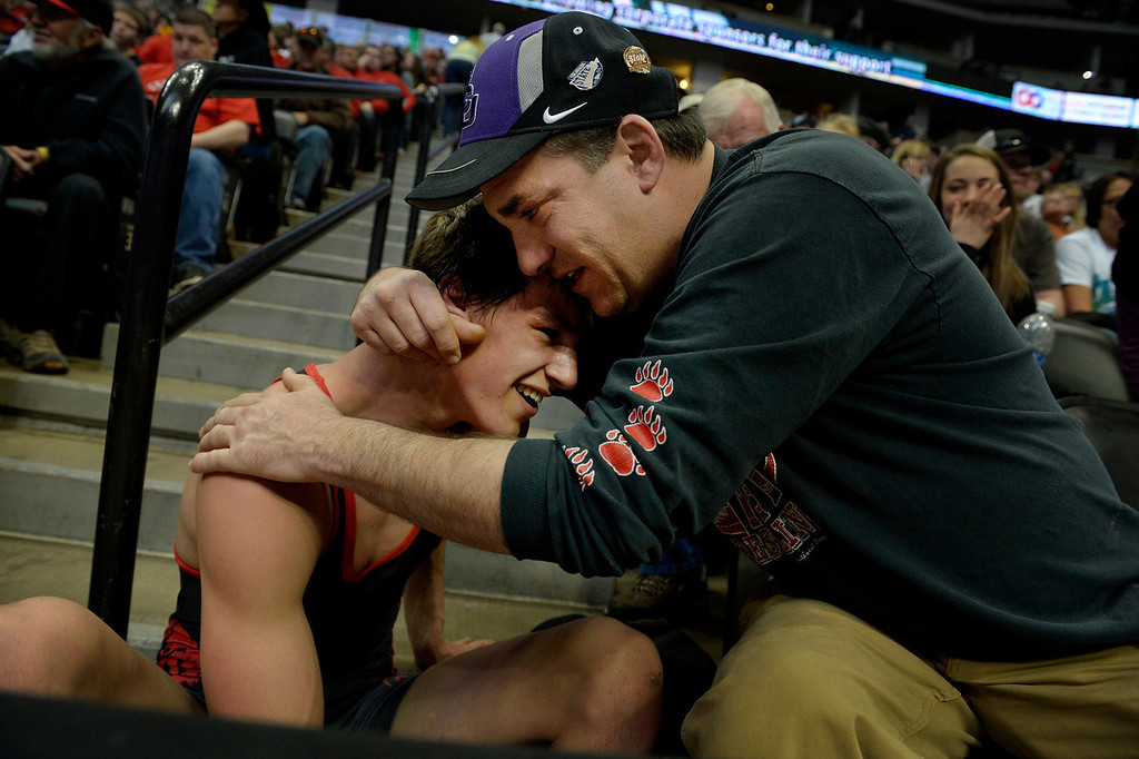 . DENVER, CO. - FEBRUARY 22: Dean Valdez hugs his son, Deano, a senior at Dolores High School, during the Colorado State Wrestling Championship at the Pepsi Center in Denver, CO February 22, 2014. Deano Valdez won his 2A 145-pound consolation match. (Photo By Craig F. Walker / The Denver Post)