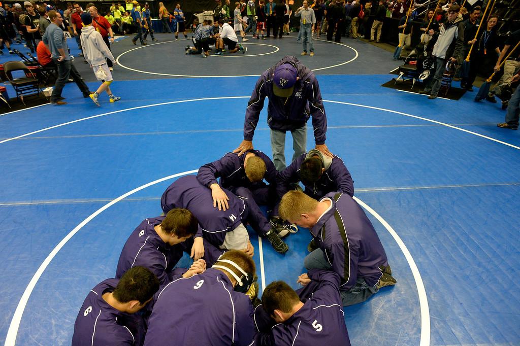 . DENVER, CO. - FEBRUARY 22: Assistant coach Don Rogers leads the Wray High School wresting team in a prayer before the consolation rounds of the Colorado State Wrestling Championship at the Pepsi Center in Denver, CO February 22, 2014. (Photo By Craig F. Walker / The Denver Post)
