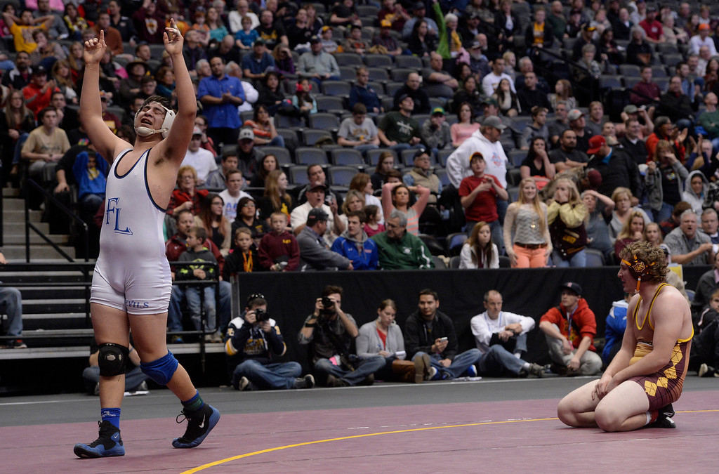. DENVER, CO - FEBRUARY 22: Jacob Ornelas of Ft. Lupton wrestles Joe Carwin in the 3A 220lb. championship match. The Colorado Wrestling Tournament was held at the Pepsi Center in Denver, Colo. on February 22, 2014. (Photo by Andy Cross/The Denver Post)