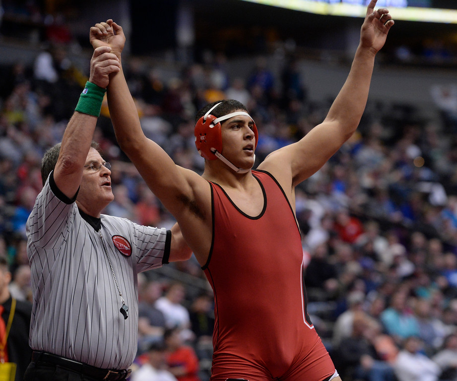 . DENVER, CO - FEBRUARY 22: Jareb Aziz of Centauri (in red) defeats Keegan Wentz of Buena Vista in the 3A 195lb. championship match. The Colorado Wrestling Tournament was held at the Pepsi Center in Denver, Colo. on February 22, 2014. (Photo by Andy Cross/The Denver Post)