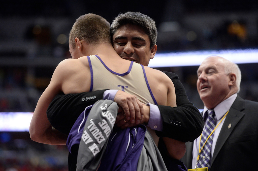 . DENVER, CO - FEBRUARY 22: Joseph Prieto of Holy Family celebrates after winning the 3A 138lb. championship match. The Colorado Wrestling Tournament was held at the Pepsi Center in Denver, Colo. on February 22, 2014. (Photo by Andy Cross/The Denver Post)