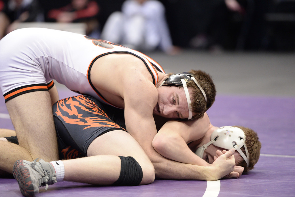 . DENVER, CO - FEBRUARY 22: Seager Oliver of Montezuma-Cortez (in white) wrestles Ladd Bunker of Erie (in black) in the 4A 170lb. championship match. The Colorado Wrestling Tournament was held at the Pepsi Center in Denver, Colo. on February 22, 2014. (Photo by Hyoung Chang/The Denver Post)
