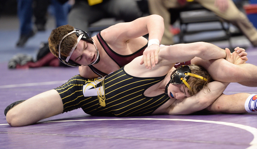 . DENVER, CO - FEBRUARY 22: Ben Hewson of Thompson Valley (in black and yellow) wrestles Jimmy Fate of Berthoud (in maroon and white) in the 4A 138lb. championship match. The Colorado Wrestling Tournament was held at the Pepsi Center in Denver, Colo. on February 22, 2014. (Photo by Hyoung Chang/The Denver Post)