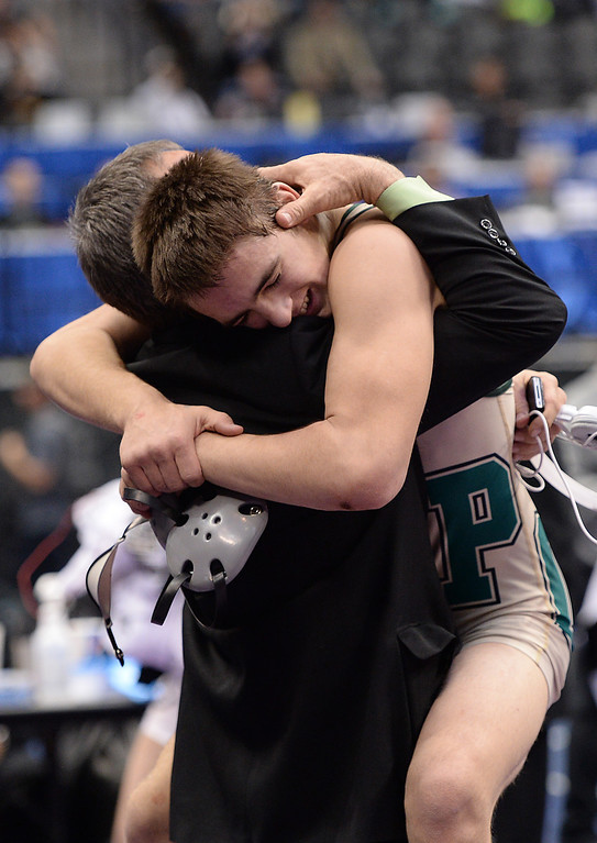. DENVER, CO - FEBRUARY 22: Hunter Willits of Pueblo County celebrates defeating Marcus Martinez of Pueblo South in the 4A 132lb. championship match. The Colorado Wrestling Tournament was held at the Pepsi Center in Denver, Colo. on February 22, 2014. (Photo by Hyoung Chang/The Denver Post)