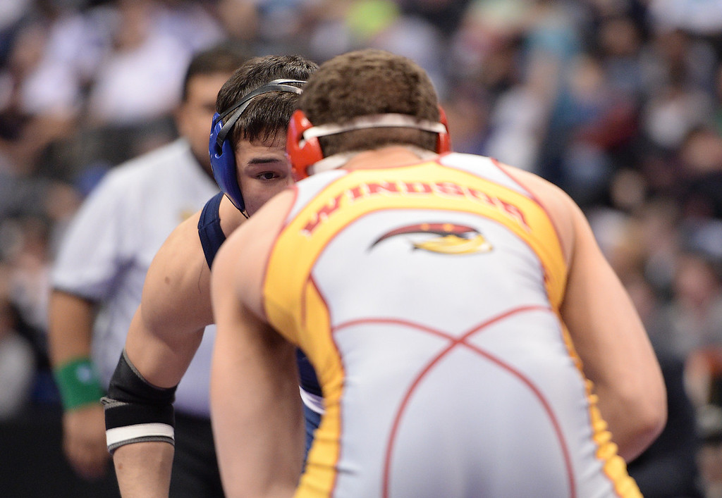 . DENVER, CO - FEBRUARY 22: Kenneth Lanteri of Windsor (in gray and yellow) wrestles Jarod Albo of Broomfield (in blue) in the 4A 152lb. championship match. The Colorado Wrestling Tournament was held at the Pepsi Center in Denver, Colo. on February 22, 2014. (Photo by Hyoung Chang/The Denver Post)