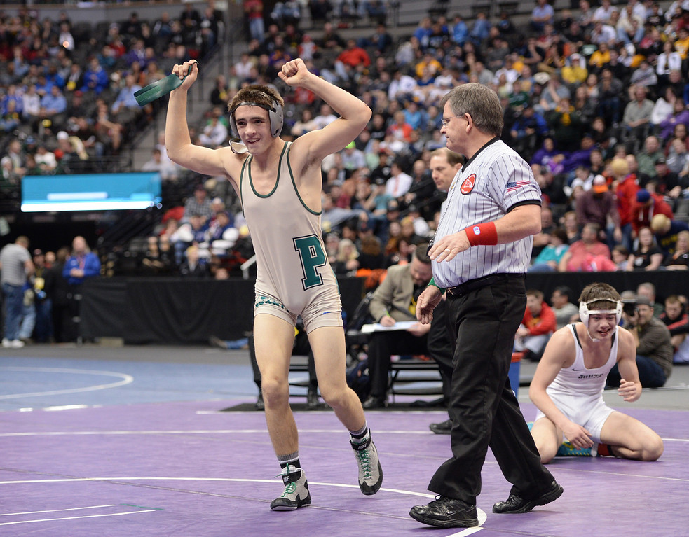 . DENVER, CO - FEBRUARY 22: Hunter Willits of Pueblo County (in tan and green) celebrates defeating Marcus Martinez of Pueblo South (in white) in the 4A 132lb. championship match. The Colorado Wrestling Tournament was held at the Pepsi Center in Denver, Colo. on February 22, 2014. (Photo by Hyoung Chang/The Denver Post)