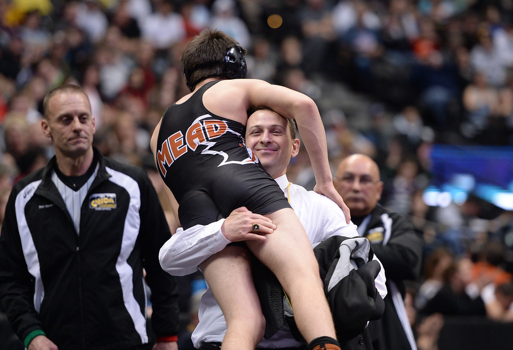 . DENVER, CO - FEBRUARY 22: Sage Budd of Mead celebrate with his coach after defeating Darek Huff of Broomfield in the 4A 126lb. championship match. The Colorado Wrestling Tournament was held at the Pepsi Center in Denver, Colo. on February 22, 2014. (Photo by Hyoung Chang/The Denver Post)