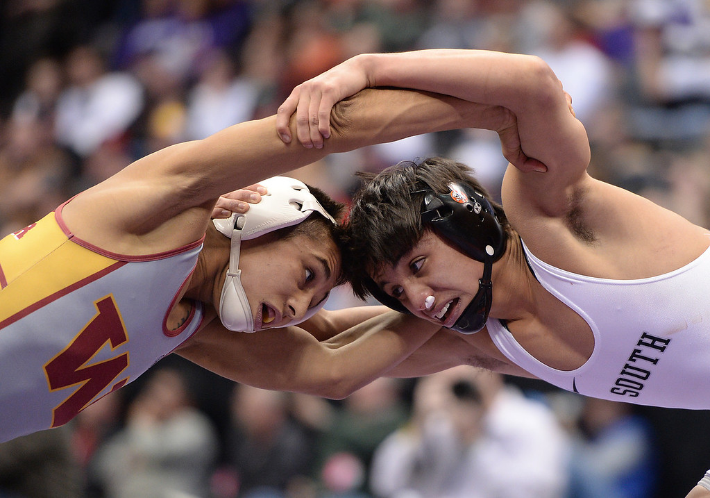 . DENVER, CO - FEBRUARY 22: Michael Ramirez of Pueblo South (in white) wrestles Josh Villa of Windsor (in white, yellow and red) in the 4A 113lb. championship match. The Colorado Wrestling Tournament was held at the Pepsi Center in Denver, Colo. on February 22, 2014. (Photo by Hyoung Chang/The Denver Post)