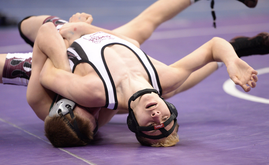 . DENVER, CO - FEBRUARY 22: Grant Willits of Pueblo County (in tan, on bottom) wrestles Randen Espinoza of Palisade (in white, black and maroon) in the 4A 106lb. championship match. The Colorado Wrestling Tournament was held at the Pepsi Center in Denver, Colo. on February 22, 2014. (Photo by Hyoung Chang/The Denver Post)