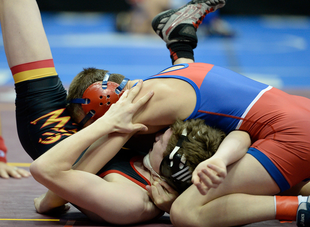 . DENVER, CO - FEBRUARY 20: Josh Finesilver of Cherry Creek takes control of Gerimie Meier of Castle View during Class 5A 106 pound action on the first day of Colorado High School State Wrestling February 20, 2014 Pepsi Center. Finesilver defeated Meier on a pin.  (Photo by John Leyba/The Denver Post)