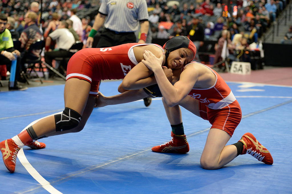. DENVER, CO - FEBRUARY 20: Maya Nelson of Denver East taking control of her match against Carl Camposanto of Regis during their 5A 106 pound match on the first day of Colorado High School State Wrestling February 20, 2014 Pepsi Center. Maya defeated Camposanto 13-9.  (Photo by John Leyba/The Denver Post)