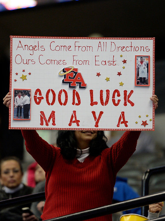 . DENVER, CO - FEBRUARY 20: Fans hold up signs for Maya Nelson of Denver East on the first day of Colorado High School State Wrestling February 20, 2014 Pepsi Center. (Photo by John Leyba/The Denver Post)