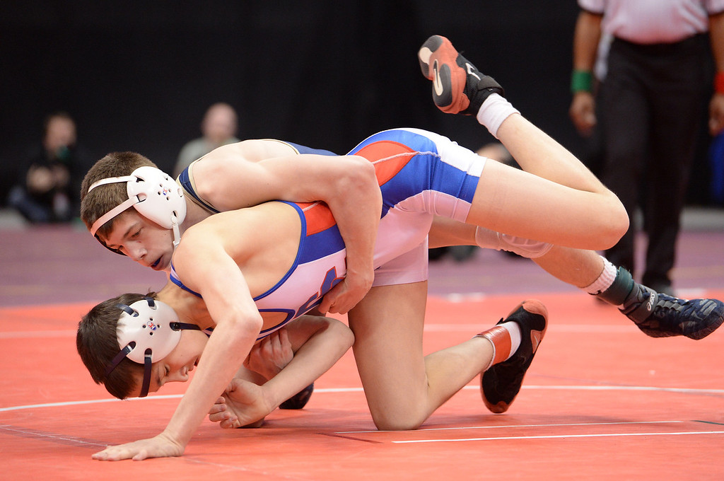 . DENVER, CO - FEBRUARY 22: Ryan Deakin of Legacy (in blue) wrestles Matt Finesilver of Cherry Creek (in white) in the 5A 113lb. championship match. The Colorado Wrestling Tournament was held at the Pepsi Center in Denver, Colo. on February 22, 2014. (Photo by Karl Gehring/The Denver Post)