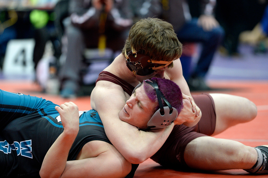 . DENVER, CO - FEBRUARY 20: Dylan Gabel of Ponderosa gets Jacob Thomas of Westminster in a headlock during their 5A 182 pound match on the first day of Colorado High School State Wrestling February 20, 2014 Pepsi Center. Gabel pinned Thomas for the win.   (Photo by John Leyba/The Denver Post)
