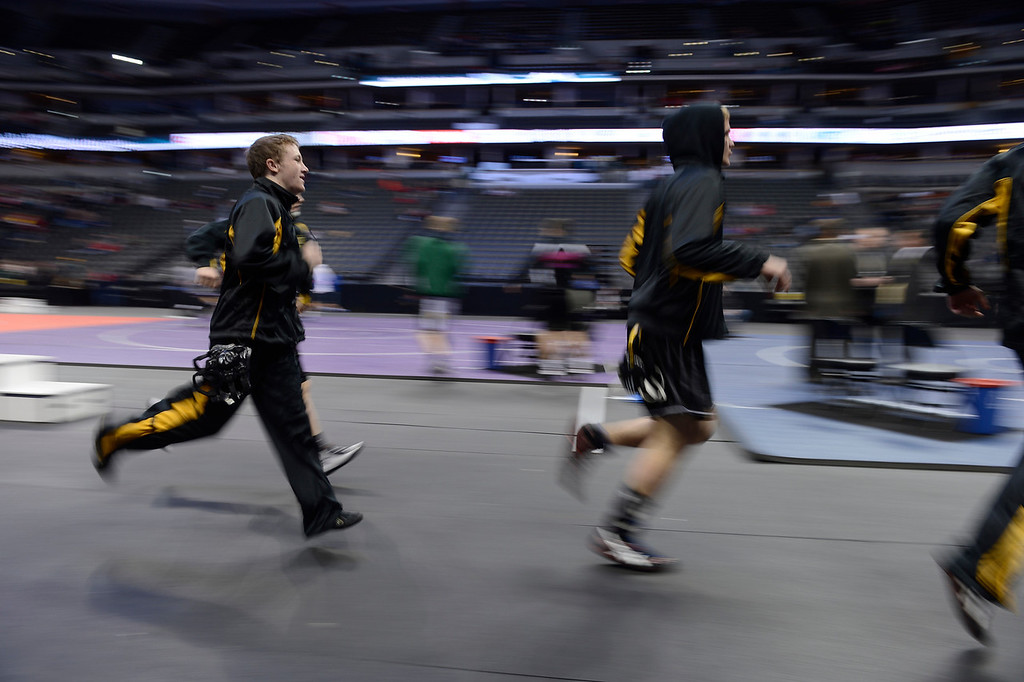 . DENVER, CO - FEBRUARY 22: Wrestlers take to the mats during the parade of champions before the start of matches. The Colorado Wrestling Tournament was held at the Pepsi Center in Denver, Colo. on February 22, 2014. (Photo by Andy Cross/The Denver Post)