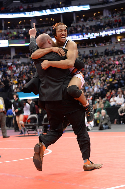 . DENVER, CO - FEBRUARY 22: Deyaun Trueblood of Gateway (in white and orange) celebrates after defeating Rashawn Benford of Fountain-Ft. Carson in the 5A 152lb. championship match. The Colorado Wrestling Tournament was held at the Pepsi Center in Denver, Colo. on February 22, 2014. (Photo by Karl Gehring/The Denver Post)