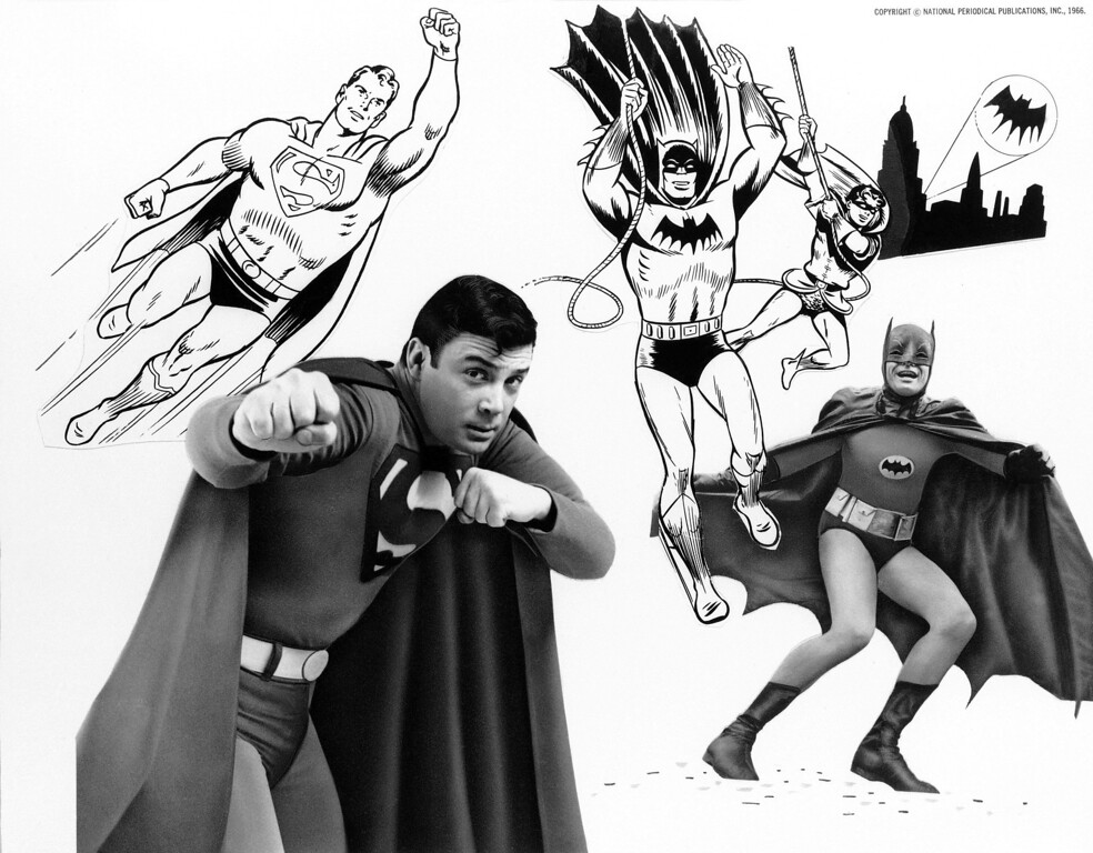 ". At left is the original Superman cartoon character, with Bob Holiday, who plays him in ""It\'s a Bird It\'s a Plane It\'s Superman,\"" a musical on Broadway, and at right is the original Batman with his Boy Wonder Robin, and in front, Adam West, in the title role of television\'s \""Batman\"", Feb. 24, 1966.  (AP Photo)"