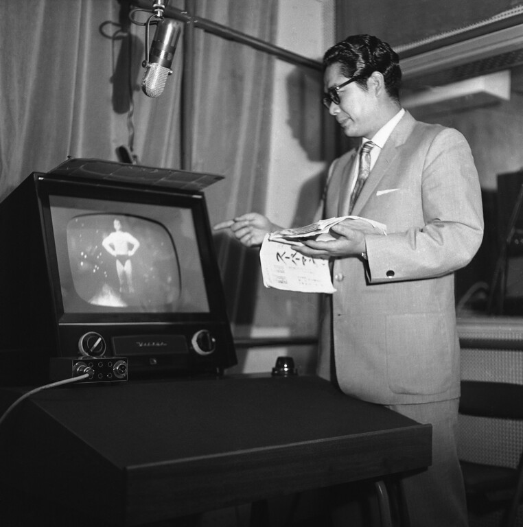 ". Tooru Ohira, the Japanese voice of televisionís Superman, watches that late actor George Reeves closely while he supplies Japanese words for Reeves\' English lip movements on July 7, 1959. Television has made a strong impression on the Japanese from Emperor Hirohito down. About 99 percent of Japanese TV shows are American, including the Emperor\'s favorite, ""Superman.\"" (AP Photo)"