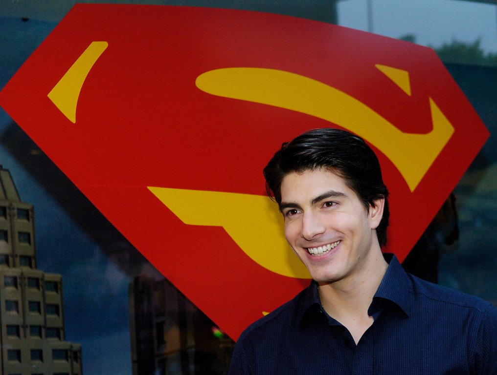 ". Brandon Routh, who plays Superman in the forthcoming film ""Superman Returns,\"" poses in front of the Superman logo before an unveiling of the film\'s apparel, accessories and fashion doll collection at Kitson boutique in Beverly Hills, May 1, 2006.    (AP Photo/Chris Pizzello)"