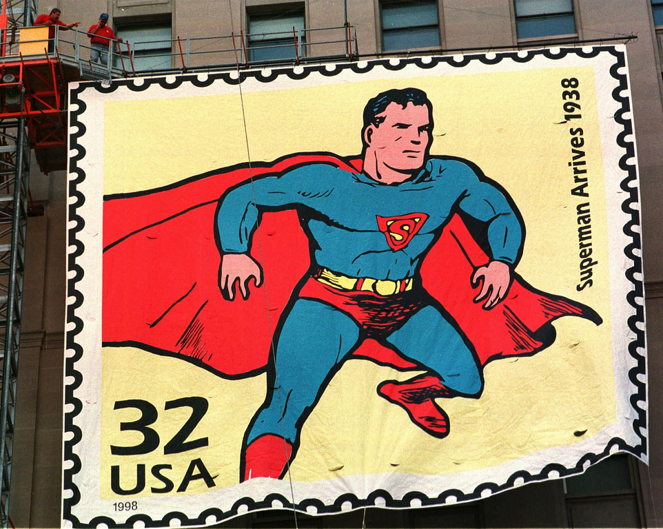 . Workers raise a five-story replica of a stamp of Superman on the Terminal Tower Thursday, Sept. 10, 1998, in Cleveland. Superman was created in Cleveland by writer Jerry Siegel and artist Joe Schuster in 1938. Superman was honored with a stamp for the first time as part of the 1930\'s edition of the United States Postal Service series Celebrate the Century. (AP Photo/Tony Dejak)