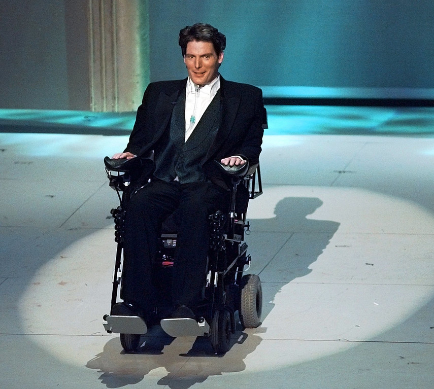 ". Christopher Reeve appears at the 68th Annual Academy Awards in Los Angeles, Monday, March 25, 1996. With many wiping away tears, Monday night s Academy Awards audience gave the tuxedo-clad Reeve a standing ovation as he sat before them in his respirator-equipped wheelchair. Paralyzed from the shoulder down in a horse-riding accident last May, the ""Superman\"" actor, urged Hollywood to produce more movies about social issues. (AP Photo/Eric Draper)"