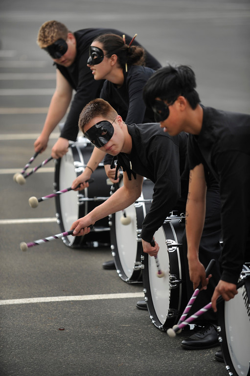 . DENVER, CO. - JULY 6:  Drummers from Harrison High School in Colorado Springs practiced in the parking lot. Members of area high school marching bands competed in a separate event Saturday afternoon. The nation\'s top drum and bugle corps entertained a crowd and battled for top honors at the Drums Along the Rockies competition at Sports Authority Field Saturday July 6, 2013. Photo By Karl Gehring/The Denver Post