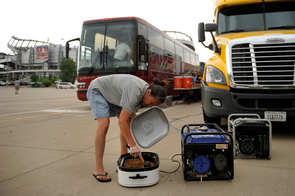 . DENVER, CO. - JULY 6:  Max Koch stirred a pot of hamburger that would feed members of the Cascades Drum and Bugle Corps from Spokane, WA Saturday afternoon.  The group made tacos in the parking lot before competition started. The nation\'s top drum and bugle corps entertained a crowd and battled for top honors at the Drums Along the Rockies competition at Sports Authority Field Saturday July 6, 2013. Photo By Karl Gehring/The Denver Post