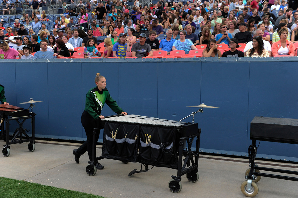 . DENVER, CO. - JULY 6:  The Cascades of Seattle, WA moved into position Saturday night. The nation\'s top drum and bugle corps entertained a crowd and battled for top honors at the Drums Along the Rockies competition at Sports Authority Field Saturday July 6, 2013. Photo By Karl Gehring/The Denver Post