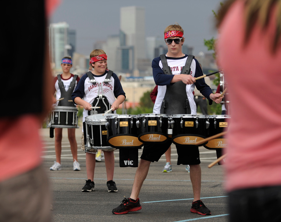 . DENVER, CO. - JULY 6:  Dakota Ridge High School drummer Jonah Simpson rehearsed outside the stadium Saturday night. Members of area high school marching bands competed in a separate event Saturday afternoon. The nation\'s top drum and bugle corps entertained a crowd and battled for top honors at the Drums Along the Rockies competition at Sports Authority Field Saturday July 6, 2013. Photo By Karl Gehring/The Denver Post