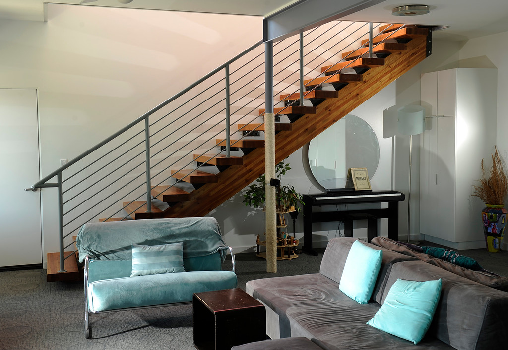 """. The home\'s bottom floor is darker and cooler than the sunlit upstairs and has two bedrooms. Applebury uses one for her office; a smaller space serves as Goeddel\'s \""""man cave.\"""" A staircase leads to a kitchen and living area. (Photo By Cyrus McCrimmon/The Denver Post)"""