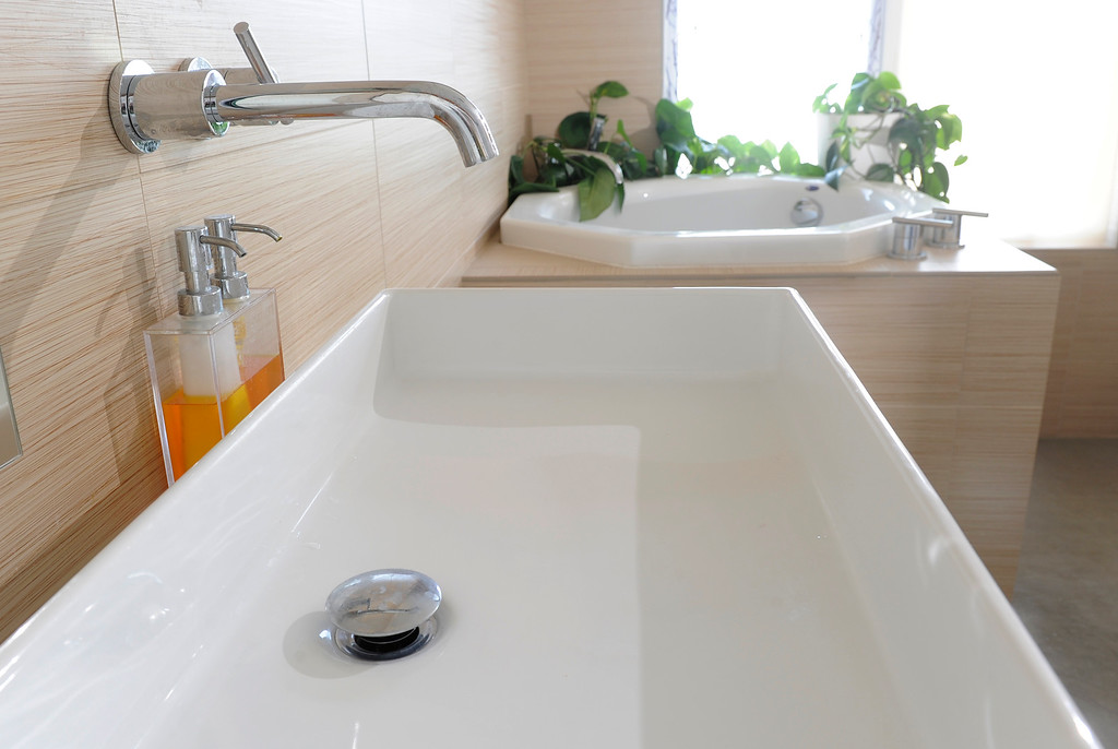 . A wall-mounted faucet and large square sink in the master bath minimize splashing. Applebury said the home is extremely easy to clean. (Photo By Cyrus McCrimmon/The Denver Post)