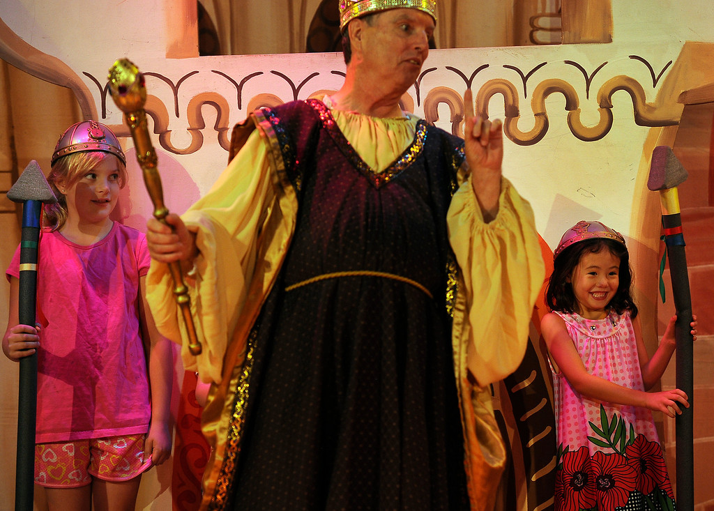 """. GOLDEN, CO - Aug. 31: The Emperor, played by actor T.J. Mullin, dances in front of his Honor Guard including  Miriam Tsai, 5, right, and Maria Seybert, 10. Kids from the audience are often invited up on stage to help during the performance. The actors at The Heritage Square Music Hall host their last performance of \""""The Emperor\'s New Clothes\"""" in the Children\'s Theatre. The theatre company, which has held performances for the past 25 years (22 for the children\'s theatre) plans to close its doors for good with a final performance on Dec. 31. 2013. \""""Sweeney Todd: The Demon Barber of Fleet Street\"""" runs in the evening dinner theatre through Nov. 10, and one more Children\'s Theatre show, \""""Santa Needs a Holiday\"""", will begin Nov. 16, 2013. (Photo By Kathryn Scott Osler/The Denver Post)"""