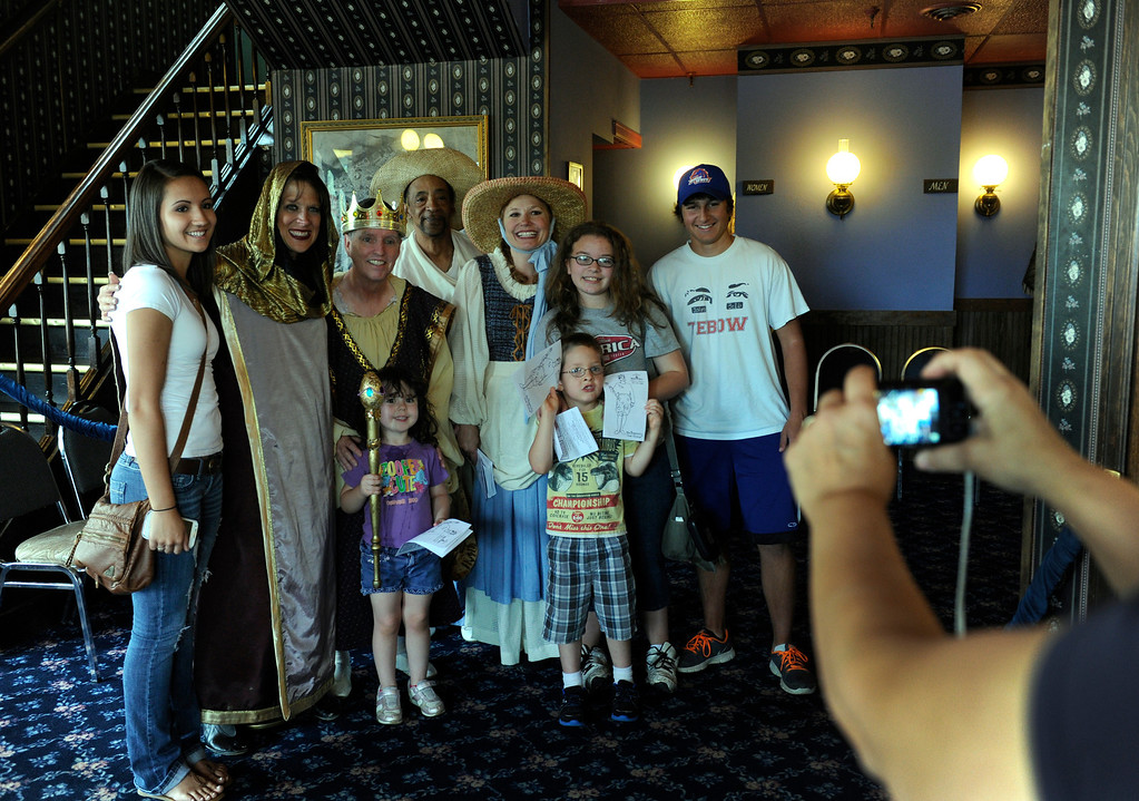 """. GOLDEN, CO - Aug. 31: Audience members pose for photos with the actors after the show. The actors at The Heritage Square Music Hall host their last performance of \""""The Emperor\'s New Clothes\"""" in the Children\'s Theatre. The theatre company, which has held performances for the past 25 years (22 for the children\'s theatre) plans to close its doors for good with a final performance on Dec. 31. 2013. \""""Sweeney Todd: The Demon Barber of Fleet Street\"""" runs in the evening dinner theatre through Nov. 10, and one more Children\'s Theatre show, \""""Santa Needs a Holiday\"""", will begin Nov. 16, 2013. (Photo By Kathryn Scott Osler/The Denver Post)"""
