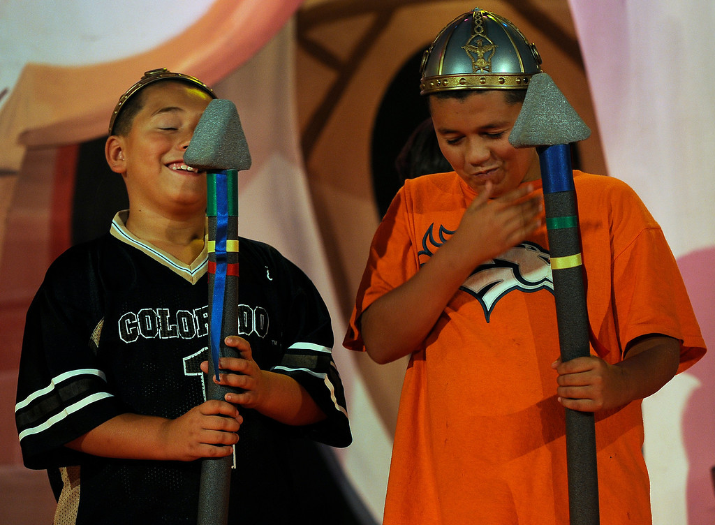 """. GOLDEN, CO - Aug. 31: Brothers Isaiah Lopez, 10, right, and brother Leo, 8, who have been invited on stage to be part of the Emperor\'s Honor Guard, can\'t contain their laughter as the actors perform. The actors at The Heritage Square Music Hall host their last performance of \""""The Emperor\'s New Clothes\"""" in the Children\'s Theatre. The theatre company, which has held performances for the past 25 years (22 for the children\'s theatre) plans to close its doors for good with a final performance on Dec. 31. 2013. \""""Sweeney Todd: The Demon Barber of Fleet Street\"""" runs in the evening dinner theatre through Nov. 10, and one more Children\'s Theatre show, \""""Santa Needs a Holiday\"""", will begin Nov. 16, 2013. (Photo By Kathryn Scott Osler/The Denver Post)"""