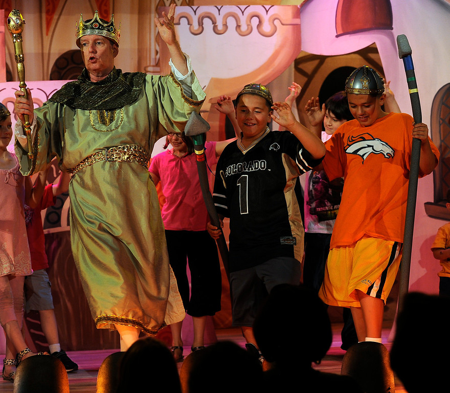 """. GOLDEN, CO - Aug. 31: Brothers Isaiah Lopez, 10, right, and brother Leo, 8, join actor T.J. Mullin (the Emperor) on stage as members of the Emperor\'s Honor Guard. The actors at The Heritage Square Music Hall host their last performance of \""""The Emperor\'s New Clothes\"""" in the Children\'s Theatre. The theatre company, which has held performances for the past 25 years (22 for the children\'s theatre) plans to close its doors for good with a final performance on Dec. 31. 2013. \""""Sweeney Todd: The Demon Barber of Fleet Street\"""" runs in the evening dinner theatre through Nov. 10, and one more Children\'s Theatre show, \""""Santa Needs a Holiday\"""", will begin Nov. 16, 2013. (Photo By Kathryn Scott Osler/The Denver Post)"""