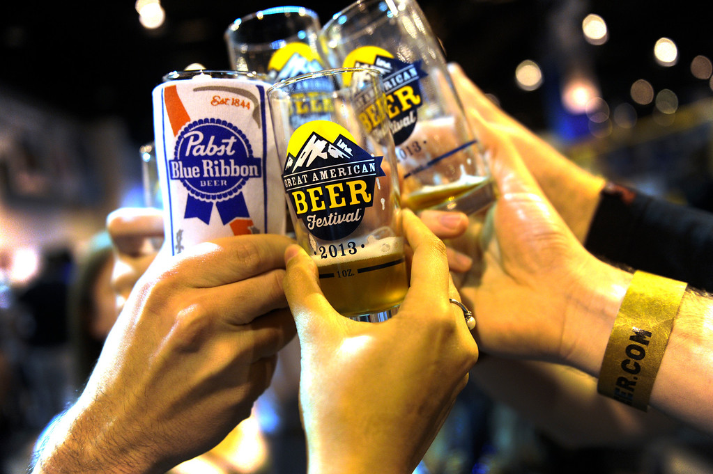 . DENVER, CO. - OCTOBER 12: A group toast was held aloft as thousands of beer fans flocked to the Great American Beer Festival at the Colorado Convention Center Saturday afternoon, October 12, 2013. Photo By Karl Gehring/The Denver Post
