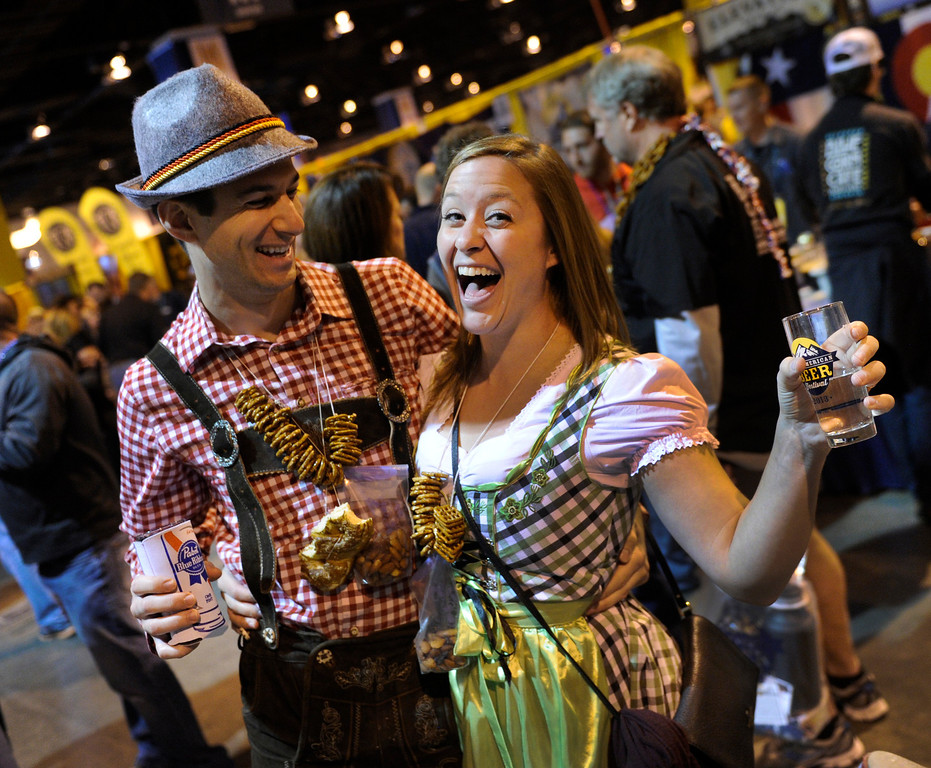 . DENVER, CO. - OCTOBER 12: Mathew Kopetsky, left, and his fiancé Ann Dalee, dressed for the event as they and thousands of beer fans flocked to the Great American Beer Festival at the Colorado Convention Center Saturday afternoon, October 12, 2013. Photo By Karl Gehring/The Denver Post