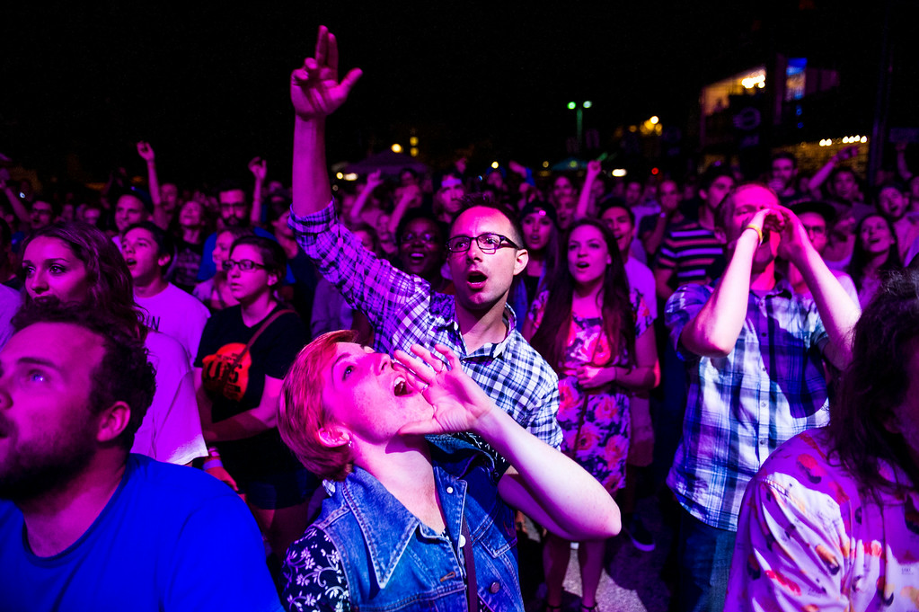 . Amanda Jo Law and Dave Hallett cheer as People Under the Stairs perform on the Underground Music Showcase main stage along South Broadway during the Annual Underground Music Showcase on Friday, July 25, 2014 in Denver, Colorado.     (Photo by Kent Nishimura/The Denver Post)