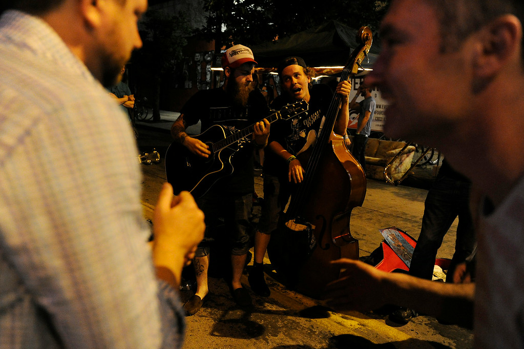 . Ryan King, left, and Neil Mitchell of Champagne Charlie perform on the street during the Underground Music Showcase on July 25, 2014 in Denver, Colorado. (Photo by Seth McConnell/The Denver Post)