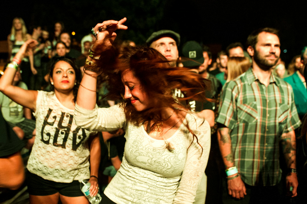 . Fans dance to the music of People Under the Stairs perform at the Underground Music Showcase main stage along South Broadway during the Annual Underground Music Showcase on Friday, July 25, 2014 in Denver, Colorado.   The music festival, which features more than 400 bands playing at venues along South Broadway continues through the weekend.  (Photo by Kent Nishimura/The Denver Post)