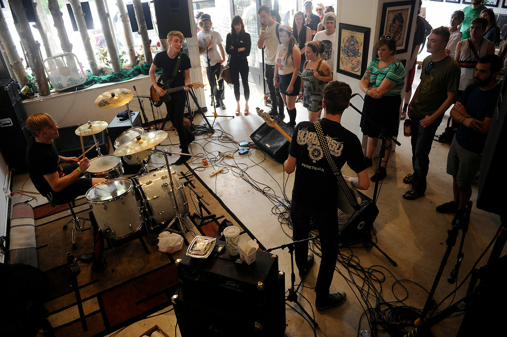 . Chase Ambler performs at the Eslinger Gallery during the Underground Music Showcase on July 27, 2014 in Denver, Colorado. (Photo by Seth McConnell/The Denver Post)