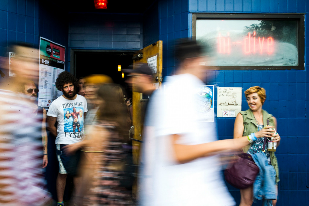 . People leave the Hi-Dive after StaG performed at the Underground Music Showcase at Hi-Dive Bar along South Broadway on Sunday, July 27, 2014 in Denver, Colorado.   The four day music festival, which features more than 400 bands playing at venues along South Broadway wraps up today. (Photo by Kent Nishimura/The Denver Post)