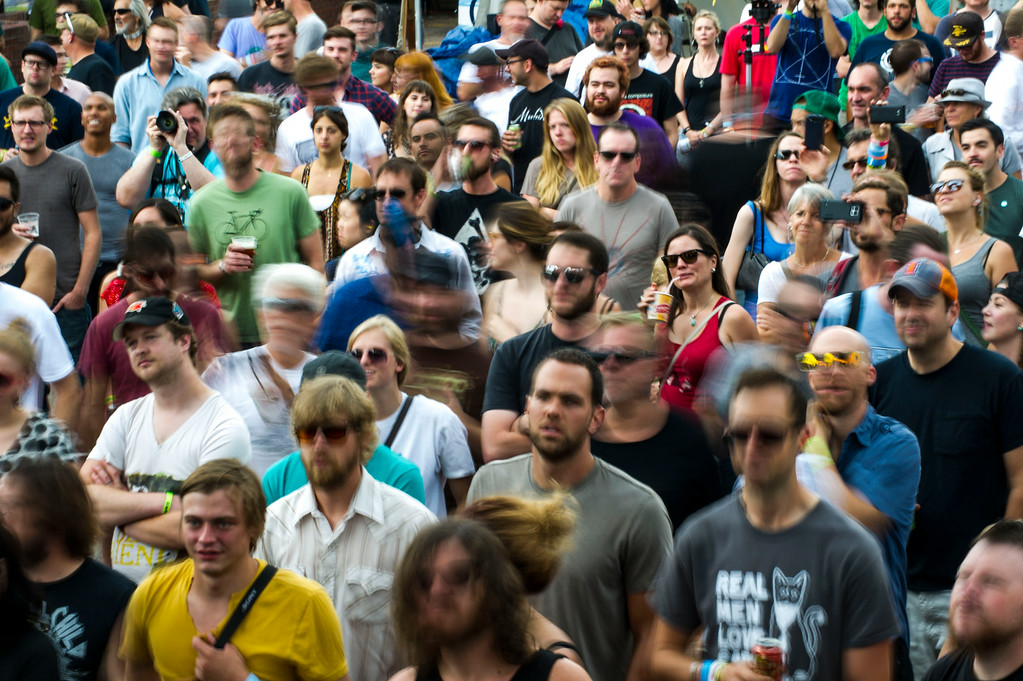 . A packed crowd is seen as Residual Kid performs at the Underground Music Showcase Main Stage at Security Service Federal Credit Union along South Broadway on Sunday, July 27, 2014 in Denver, Colorado.   The four day music festival, which features more than 400 bands playing at venues along South Broadway wraps up today. (Photo by Kent Nishimura/The Denver Post)