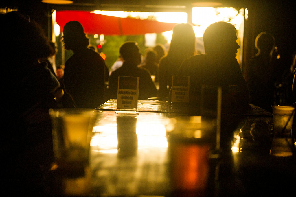 . People are seen at Gary Lee\'s Motor Club and Grub along South Broadway during the Annual Underground Music Showcase on Friday, July 25, 2014 in Denver, Colorado.      (Photo by Kent Nishimura/The Denver Post)