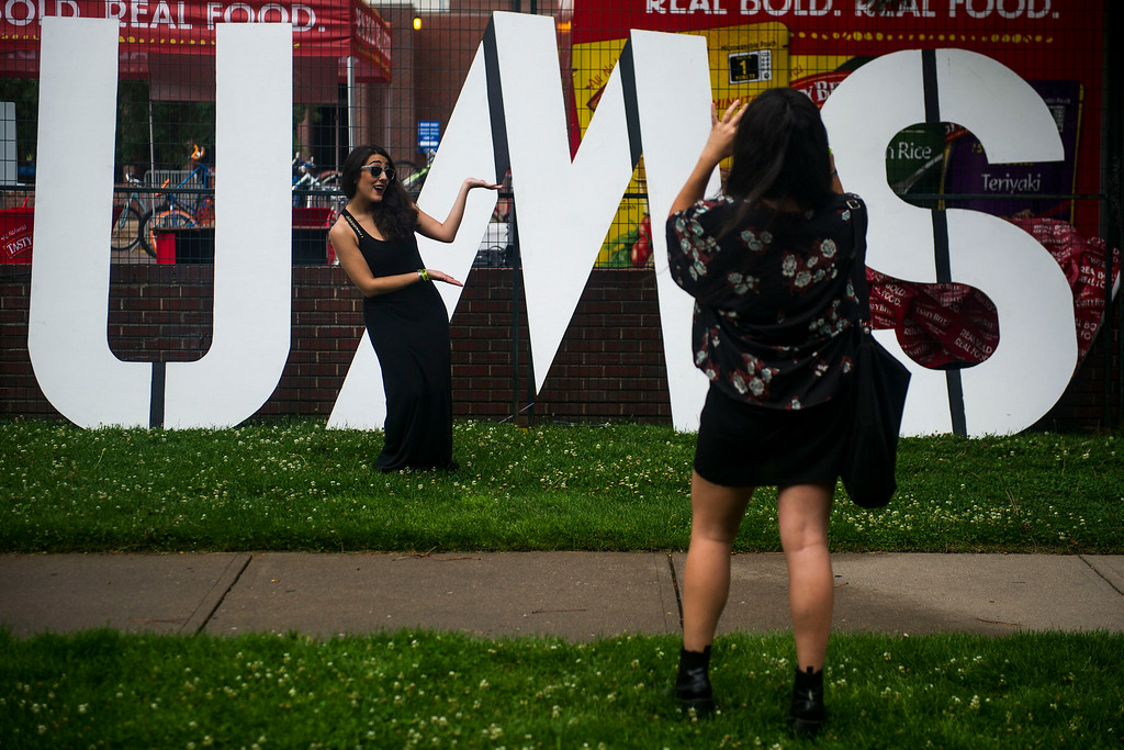 . Mehry Eslamini poses for a picture taken by Tiara Roxanne in front of the Underground Music Showcase along South Broadway during the Annual Underground Music Showcase on Friday, July 25, 2014 in Denver, Colorado.   The music festival, which features more than 400 bands playing at venues along South Broadway continues through the weekend.  (Photo by Kent Nishimura/The Denver Post)