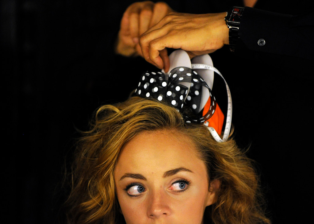 . DENVER, CO - SEPTEMBER 6:  Model Brianna Tonn has her hair piece done by stylist Ergün Tercan  backstage at the Fashion Group International of Denver\'s Rising Star 2013 fashion show on Friday September 6, 2013  at the McNichols Building in Denver. (Photo By Cyrus McCrimmon/The Denver Post )