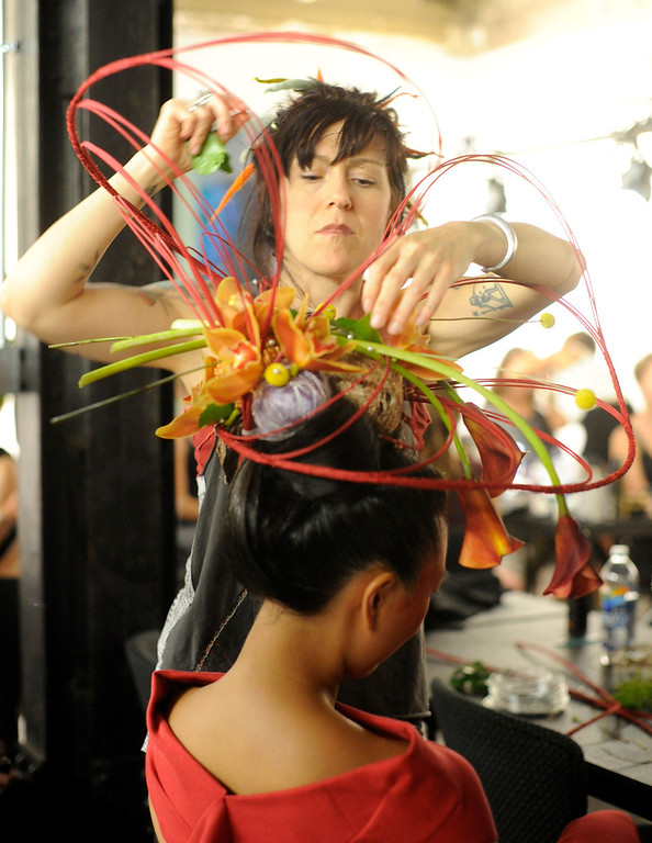 . DENVER, CO - SEPTEMBER 6: Amie Oakley works on an Arthur Williams floral head piece creation on the model Catina Shoemaker backstage at the Fashion Group International of Denver\'s Rising Star 2013 fashion show on Friday September 6, 2013  at the McNichols Building in Denver. (Photo By Cyrus McCrimmon/The Denver Post )