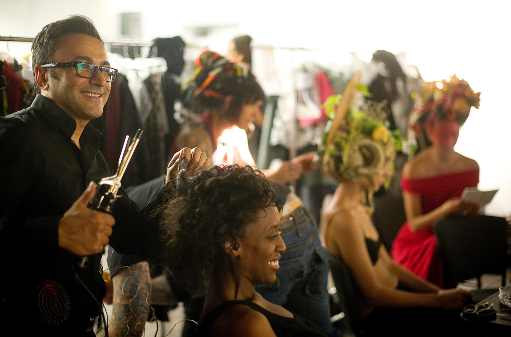 . DENVER, CO - SEPTEMBER 6:  Stylist Ergün Tercan does his hair magic backstage at the Fashion Group International of Denver\'s Rising Star 2013 fashion show on Friday September 6, 2013  at the McNichols Building in Denver. (Photo By Cyrus McCrimmon/The Denver Post )