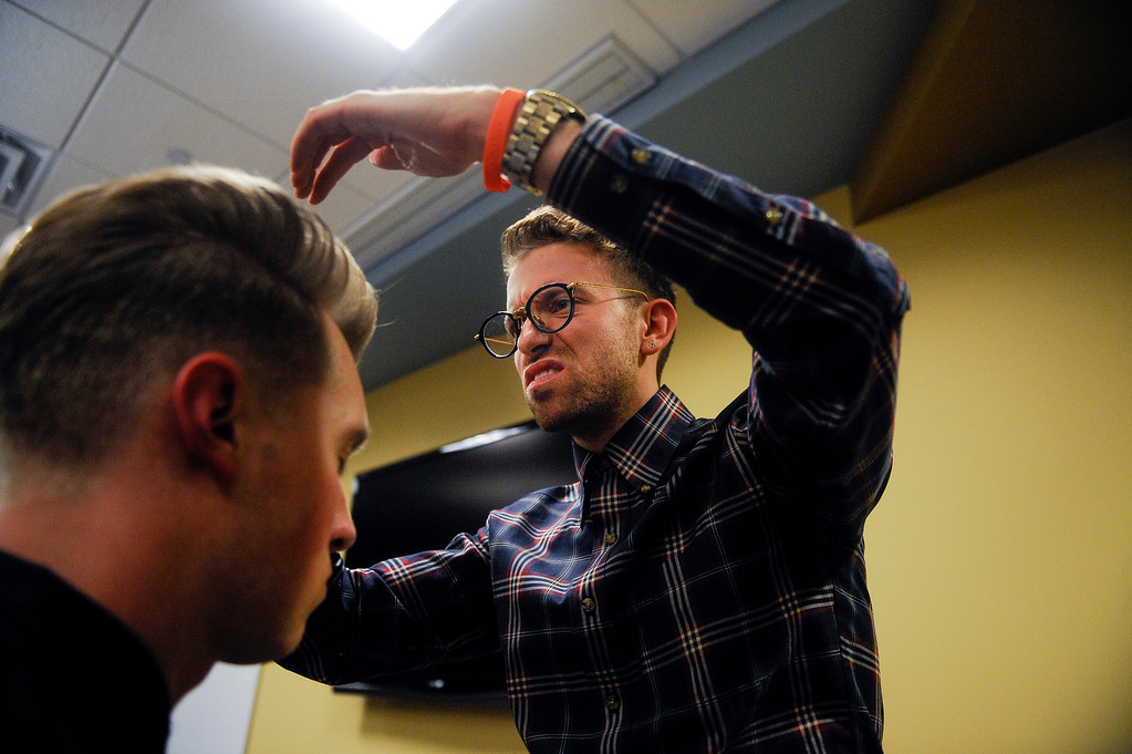 . Hairstylist Jacob Rozenberg fixes Miles Wartes\'s hair backstage. A fashion show was held at Infinity Park Events Center in Denver, CO on Nov. 3, 2013 for the American Crew man\'s debut of their 2014 collection: The Independent. The show also featured the announcement of the U.S. and Canadian winners of the American Crew All-Star Challenge. Rozenberg was the winner of the Canadian challenge. (Photo By Erin Hull/The Denver Post)