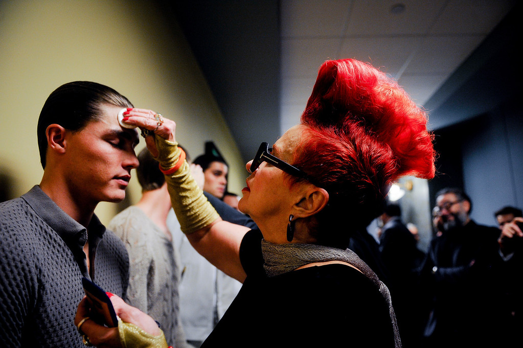 . Mary Ann Hogan fixes model Isaac Weber\'s makeup before the show. A fashion show was held at Infinity Park Events Center in Denver, CO on Nov. 3, 2013 for the American Crew man\'s debut of their 2014 collection: The Independent. (Photo By Erin Hull/The Denver Post)